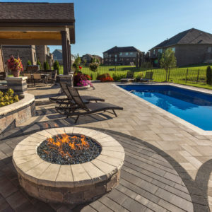 Unilock Umbriano Paver Patio with Brussels Dimensional Wall, Pillars & Fire Pit